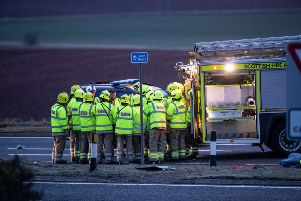 Emergency services at the scene of the crash in March