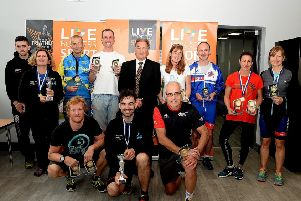 Live Borders chairman Bill White accompanies the winners from the Selkirk Standard Triathlon held on Sunday (picture by Alwyn Johnston).