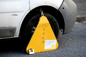 A specialist team will clamp vehicles of owners who will not pay their fine.