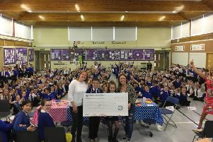 Members of the parent council visited Whiteelees Primary to present the cheque
