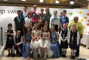 Some of the participants from this year's swimming gala with the Civic Week royal party and North Lanarkshire provost Jean Jones