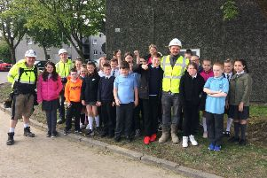 Abronhill Primary pupils with Lovell construction site manager Kevin Kelly as they visited the Cedar Road development