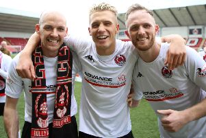 Tom Lang (centre) celebrates with Kevin Nicoll and Martin McNiff after Clyde's promotion play-off win over Annan (pic by Craig Black Photography)