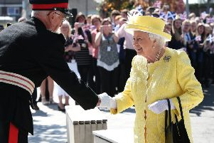 The Queen is welcomed to Greenfaulds High by Rear Admiral Michael Gregory the Lord Lieutenant of Dunbartonshire