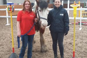 Frances Cape (right), of East Fife & Scooniehill Riding for the Disabled, with ExxonMobil employee Martha Cape.