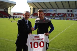 Danny Lennon presents David Goodwillie with a special jersey to mark his 100th games for Clyde (pic: Craig Black Photography).