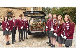 St Ninian's pupils who carried the Relics of St Therese of Lisieux into St Mirin's RC Cathedral (Photo: Paul Mc Sherry)