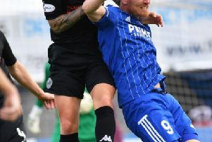 Scott Rumsby wins an aerial duel with Peterhead's Rory McAllister (pic: Duncan Brown)