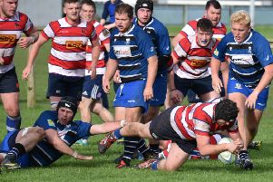 Rory Johnstone dives over for Howe's second try. Pic by Chris Reekie.