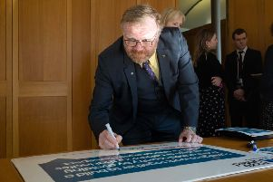 Martyn Day MP signs the proposed Parliamentary Code of Conduct.