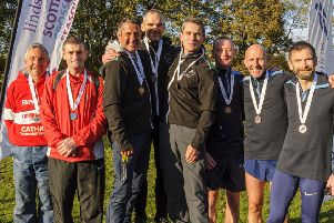 Cumbernauld AAC's Ross McEachern, Paul McMonagle and Vincent Carroll (trio on the right) after receiving their medals. (Pic: Bobby Gavin/Scottish Athletics)