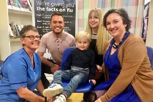 Actor Jordan Young joins nurse Fiona Todd (left), Albert Miller-Duff (4) and his mum Alison Miller-Duff, and Nuala Healy, lead for immunisation at NHS Scotland, to urge those most at risk to get vaccinated to protect them from flu.