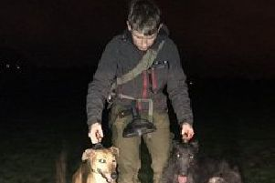Connor, pictured with two of his dogs.