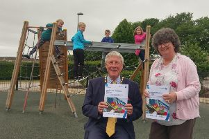 Cllr Gillian Owen, Education and Childrens Services Committee chair and Provost of Aberdeenshire, Cllr Bill Howatson with children from Kintore School