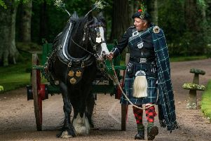 Socks with owner Derek Gray during the 2017 Lonach march.