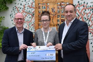 Emma Paterson from Scarf receives a cheque for �1,000 from Steve Crabb of Scottish Gas and North-east MSP Kevin Stewart.