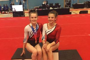 Brooke Masson, left, with her silver medal and Teagan Batho at Guildford earlier this month