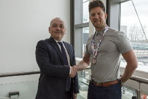 Kirkintilloch curler Ross Paterson is congratulated on his success by Councillor Billy Hendry
