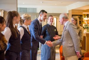 Prince Charles meets members of the Douneside House team