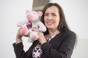 Karen Stewart and her Little Piggy mascot