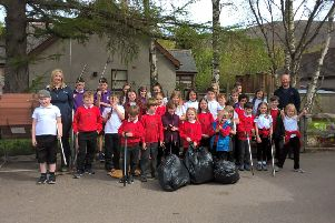 Rangers Kim Neilson and Ben Dolphin with the young litter pickers