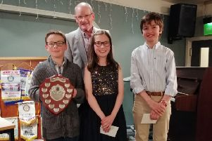 Aeden Dufton with the Speechmaker Shield, Jessica Barr, Gu Pais and  Rotary president Harry McNab.