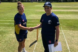 Gala and Scotland U17 Girls captain Charis Scott, right, shakes hands with opposing Durham captain Layla Tipton at the start of Monday's match at Meigle Park.