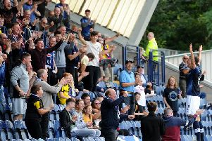 Grant Anderson (right) steps onto the wall at the front of the South Stand as he celebrates his goal with the Raith fans. Pic: Fife Photo Agency