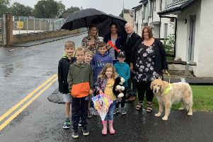Residents of Liddesdale Road and Stonefield Place in Hawick handing over a petition to councillor Davie Paterson protesting about suggestions that double yellow lines there be removed.