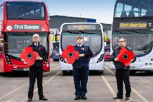 Drivers John Skinner, Ian Dixon and Ally Ferris promote free travel for all Veterans, Cadets and armed forces personnel for this year's Remembrance Sunday events (Photo: Lenny Warren / Warren Media)