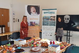 Moira Murawiecka, left and Sophia Siwek, both with Safewell Solutions, get ready for the bake sale