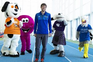 Robbie Simpson pictured with the colourful mascots from some of the RunBalmoral official race charities