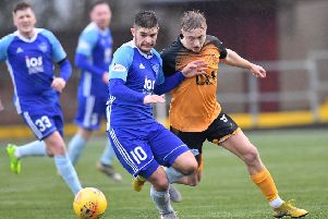Peterhead's Jack Leitch holds off Aidan Smith (Pic by Duncan Brown)