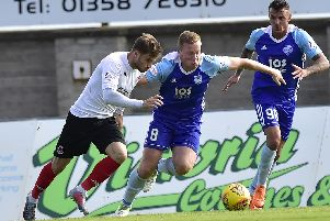 Peterhead midfielder Scott Brown up against David Goodwillie