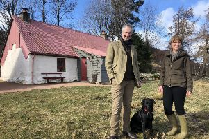 Calum and Jackie Innes at restored Downie's Cottage