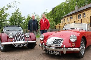 Former club president Eddie Gillanders, left, and event organising secretary Neil Booth with two of the vintage cars which will be on display