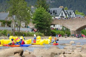 The giant duck race on the Dee is the main event of the day and draw huge crowds