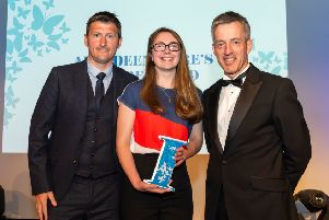 Clara Gray and her award with the council's chief executive Jim Savege, right, and Neil Scally from sponsors Findel. Picture: Aberdeenshire Council