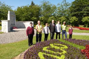 The young designers with gardeners Tom Kelley, left, and Allan Paul, and Legion official Chris Collins