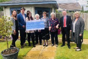 Leys Group representatives hand over a cheque for more than �12,000