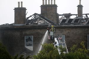 Fighter-fighters attend a major fire at Glasgow Golf Club, one of the oldest and most prestigious in the world, which has gutted most of the building. September 21, 2018.