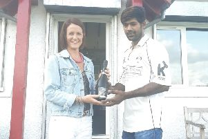 Gala CC's Sid Siddhu is presented with his man of the match award by Debbie Paterson, of main club sponsor Sinclair Duncan, on Gala Cricket Club's Supporters Day.