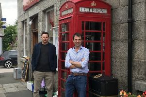 Councillor Robbie Withey and MP Andrew Bowie at the phone box in Monymusk