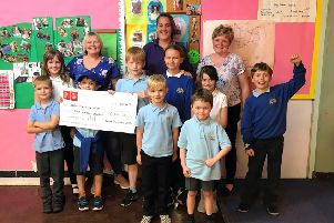 Aboyne After School Club received its cheque from Karen Smith, left, and Morag McBeath, right
