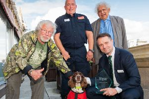 Presenter Bill Oddie, Diesel's handler Gary Carroll, host Lord Desai,  and lower right IFAW UK director James Sawyer
