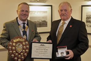 Banchory Show stalwart Gordon Christie, right, receives the Unsung Hero award from RNAS president, Keith Walker