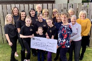 Eunice Gardyne is presented with the cheque from the All Dolled Up team, flanked by some of the club trustees and volunteers
