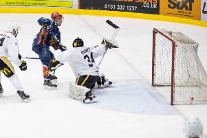 Denis Trakanov Opens Edinburghs scoring with an over the shoulder shot. Pic: Ian Coyle