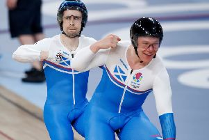 Scotland's Neil Fachie (left) and pilot Matt Rotherham celebrate winning gold in the Men's B&VI 1000m Time Trial. Picture: PA