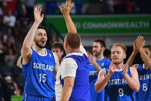 The Scotland players celebrate their win over England